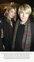 Musician NICK RHODES and MISS MEREDITH OSTROM, at a party in London on 13th November 2001.OUE 137