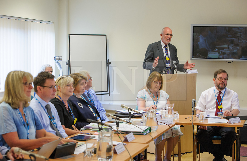 © Licensed to London News Pictures.  04/07/2017; Weston-super-Mare, North Somerset, UK. GRAHAME PAINE, chairman of the Weston Area Health NHS Trust addresses a public board meeting at Weston General Hospital. A protest was held against the overnight closure of Weston General Hospital Accident and Emergency department is held before the Weston Area Health NHS Trust  Board meeting at Weston General Hospital which is to agree the temporary overnight closure of the Accident & Emergency department because of staffing levels, with no projected date given for a return to 24hr service. It was announced last month the A&E unit would be closing between 10pm and 8am from Tuesday 04 July, after a Care Quality Commission inspection raised concerns over the long-term sustainability of staffing levels. The decision has been made on patient safety grounds because the trust cannot provide enough specialist hospital doctors to safely staff the A&E department overnight. Patients arriving by ambulance will instead be taken to either the BRI or Southmead in Bristol, or Taunton's Musgrove Park hospitals, and anyone who would otherwise turn up to the A&E department themselves is being urged to either try to get to Bristol or ring the NHS helpline on 111. Unison, the trade union representing health workers, said it was vital the NHS bosses running Weston's hospital had a plan in place to reinstate the 24 hour service as soon as possible, so the temporary closure didn't become permanent. Unison says the closure comes from a staffing shortage that is the direct result of the government running down the NHS, and that on the week of the NHS' 69th birthday, they value this national treasure and the staff who keep it going more than ever. A hospital spokesman said they had no choice to close the unit after the CQC report rated the A&E department 'inadequate', and that A&E has been fragile for several years as a result of ongoing challenges around medical recruitment and a national sho