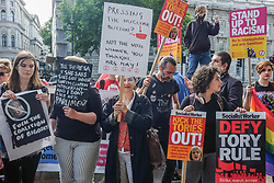June 9, 2017 - London, England, United Kingdom - Dozens gather at Downing Street in London on June 9, 2017 to stage an anti-Theresa May demonstration. They demanded the prime minister resign and refused to accept the conservative/Tory win, which left the country with a hung parliament. (Credit Image: © Jay Shaw Baker/NurPhoto via ZUMA Press)