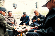 Group of old chinese men playing domino in a street of Beijing, China, Asia, 2011