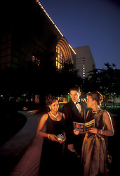 Stock photo of theater goers outside of the Hobby Center in Houston Texas after a night show