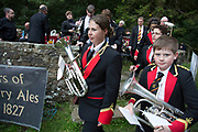 The Hardraw Scaur Brass Band Festival. Massed bands performance. Organised by the Yorkshire and Humberside Brass Band Association, the competition is Britain's second oldest outdoor contest and takes place annually in Hardraw Scar in Wensleydale, North Yorkshire, England, UK. The area, a natural amphitheatre, attracts bands from all over the North of England and is a popular event amongst players and audiences alike. The traditional end to the day takes the form of an impromptu concert given by the massed bands drawn from those who have competed in the contest.