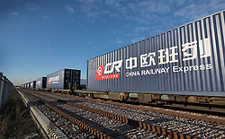 © Licensed to London News Pictures. 18/01/2017. London, UK.  Containers wait to be unloaded from the first direct rail freight train from China at Barking Rail Freight Terminal east of London. The new service set off from China on the 3rd of January this year. London is now the 15th European city to join what the Chinese government calls the New Silk Route. Photo credit: Peter Macdiarmid/LNP