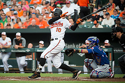 July 19, 2017 - Baltimore, MD, USA - The Baltimore Orioles' Adam Jones (10) hits a solo home run against the Texas Rangers in the first inning at Oriole Park at Camden Yards in Baltimore on Wednesday, July 19, 2017. The Orioles won, 10-2. (Credit Image: © Michael Ares/TNS via ZUMA Wire)