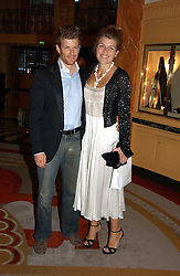 AMBER NUTTALL and TOM AIKENS at a party to celebrate the opening of The Bar at The Dorchester, Park Lane, London on 27th June 2006.<br /><br />NON EXCLUSIVE - WORLD RIGHTS