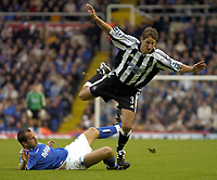 Fotball<br /> Premier League 2004/05<br /> Birmingham v Newcastle<br /> 3. oktober 2004<br /> Foto: Digitalsport<br /> NORWAY ONLY<br /> Newcastle's Lee Bowyer (R) is brought down by Stephen Clemence, for which Clemence was shown the yellow card