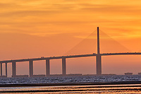 Sun rising under the Sunshine Skyway bridge from Fort De Soto Park. 1 of 4 images taken with a Fuji X-H1 camera and 200 mm f/2 OIS lens with a 1.4x teleconverter (ISO 400, 280 mm, f/16, 1/80 sec). Raw images processed with Capture One Pro and AutoPano Giga Pro.