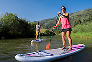 Stand Up Paddleboarding in the Roaring Fork River in Aspen, Colorado.