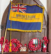Village parish church All Saints, Eyke, Suffolk, England, UK - British Legion flag banner