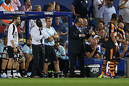 Jimmy Floyd Hasselbaink, the QPR manager (l) looks on concerned about his team while Rafa Benitez, the Newcastle United manager gives instructions to his players. EFL Skybet football league championship match, Queens Park Rangers v Newcastle Utd at Loftus Road Stadium in London on Tuesday 13th September 2016.<br /> pic by John Patrick Fletcher, Andrew Orchard sports photography.