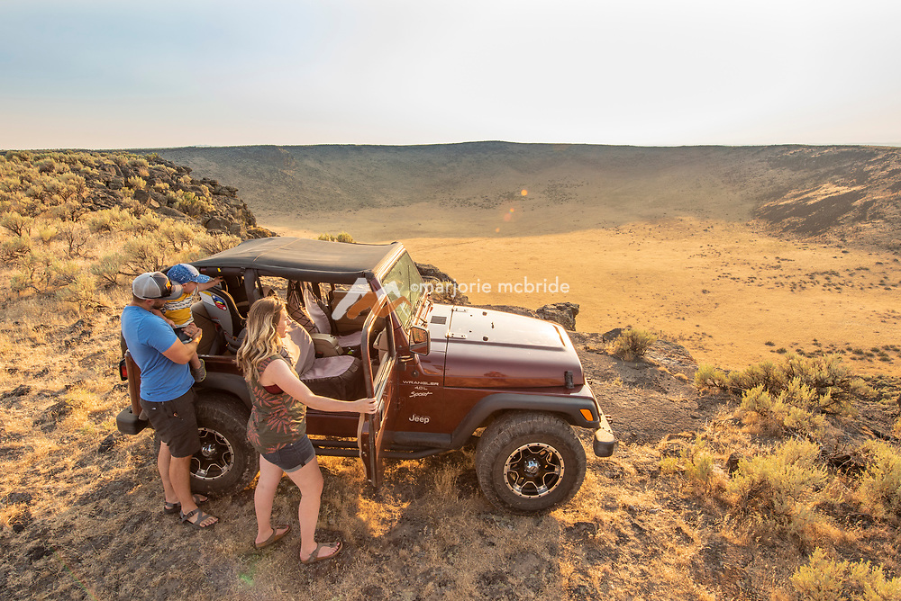 Family jeeping above the Dietrich Crater in Dietrich, Idaho.