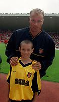 Dennis Bergkamp with the Arsenal mascot. Sunderland 1:0 Arsenal. FA Premiership,19/8/2000. Credit Colorsport / Stuart MacFarlane.
