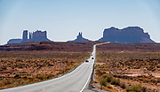 From U.S. Route 163 in Utah, see rock pinnacles & mesas of Monument Valley in Arizona, USA. This scenic turnout is 13 miles north of the Arizona–Utah border.
