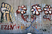 Drawings on the Palestinian side of the Israeli Separation Wall in Abu Dis, few minutes away from Jerusalem, on Wednesday, Nov. 9, 2005. **ITALY OUT**