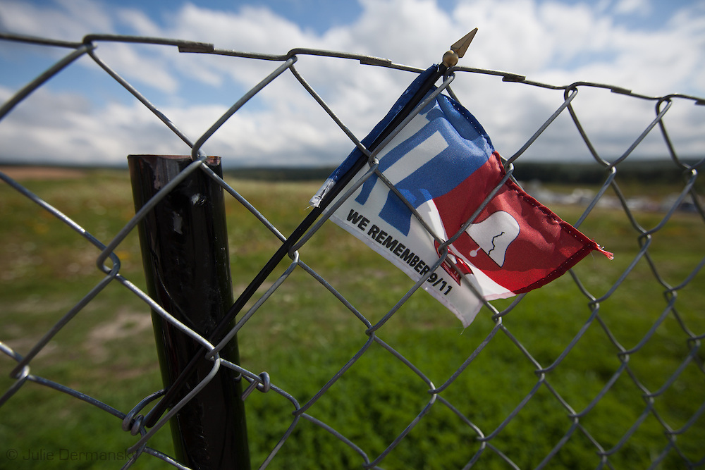 flag at  Flight 93 National Memorial site's temporary memorial  overlooking the field where the flight crashed in Shanksville, Pennsylvania. The temporary site will close on Sept. 9th at 4 P.M. and on Sept. 10 the official memorial will open in time for the 10th anniversary of 9/11