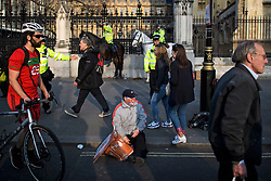 © Licensed to London News Pictures. 29/03/2019. London, UK. A lone Brexit supporter is seen sitting on the pavement outside the Houses of Parliament, after MPs rejected Theresa May's withdrawal agreement. Photo credit: Ben Cawthra/LNP