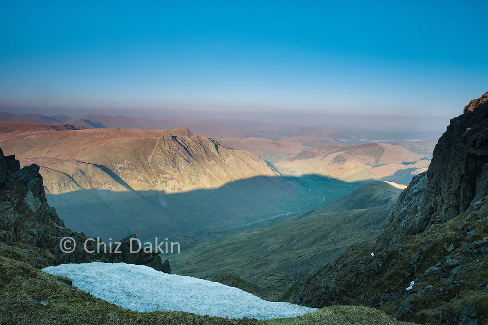 """Staying up late on Bowfell extends time in the sun after the shadows fall on Langdale itself - but beware the time it takes to descend """"The Band""""!"""