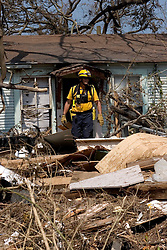26th Sept, 2005. Cameron, Louisiana.  Hurricane Rita aftermath. <br /> Members of the Las Vegas, Nevada Task Force 1, a FEMA search and rescue team scour the destroyed remains of houses and business in Cameron, Louisiana for any signs of life.<br /> Photo; ©Charlie Varley/varleypix.com