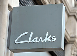 File photo dated 06/01/16 of a shop sign for Clarks in central London, as the footwear firm has sparked a sexism row after naming a girls' shoe range Dolly Babe and a boys' line Leader.