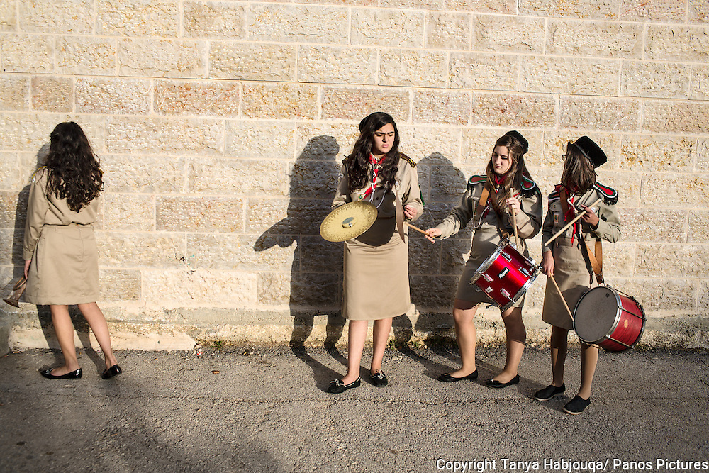 "The Palestinian Girl Scouts of Ramallah at band practice.<br /> <br /> Faiza (cymbols) and her family left Gaza after Israeli military incursions of last summer. Her family said 'enough'.  Founded in 1912, the scouts are a long respected Palestinian institution and their charter ""accepts all diversity of Palestinians, to promote values  in creating a better world."" The girls joked they were on cusp of making their own rock and roll all girl band."