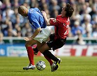 Photo. Richard Lane, Digitalsport..<br /> Portsmouth v Manchester United. FA Barclaycard Premiership. 17/04/2004.<br /> Gary Neville challenges Nigel Quashie.