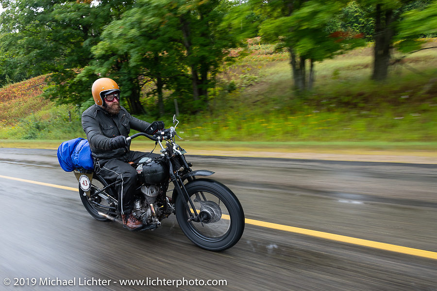 Artist Jeff Durrant riding his 1942 Harley-Davidson WLC bobber in the Artist Jeff Durrant riding his 1942 Harley-Davidson WLC in the Cross Country Chase motorcycle endurance run from Sault Sainte Marie, MI to Key West, FL. (for vintage bikes from 1930-1948). Stage 1 from Sault Sainte Marie to Ludington, MI USA. Friday, September 6, 2019. Photography ©2019 Michael Lichter.