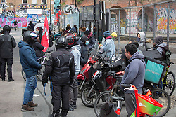 © Licensed to London News Pictures.  07/04/2021. London, UK. Deliveroo riders gather at Shoreditch High Street Station in east London to demand better pay, better rights & safety. Photo credit: Marcin Nowak/LNP