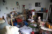 Inside untidy art student teenager's bedroom
