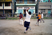 Boys playing cricket at the Jupiter Sports Club in Chandannagar, India