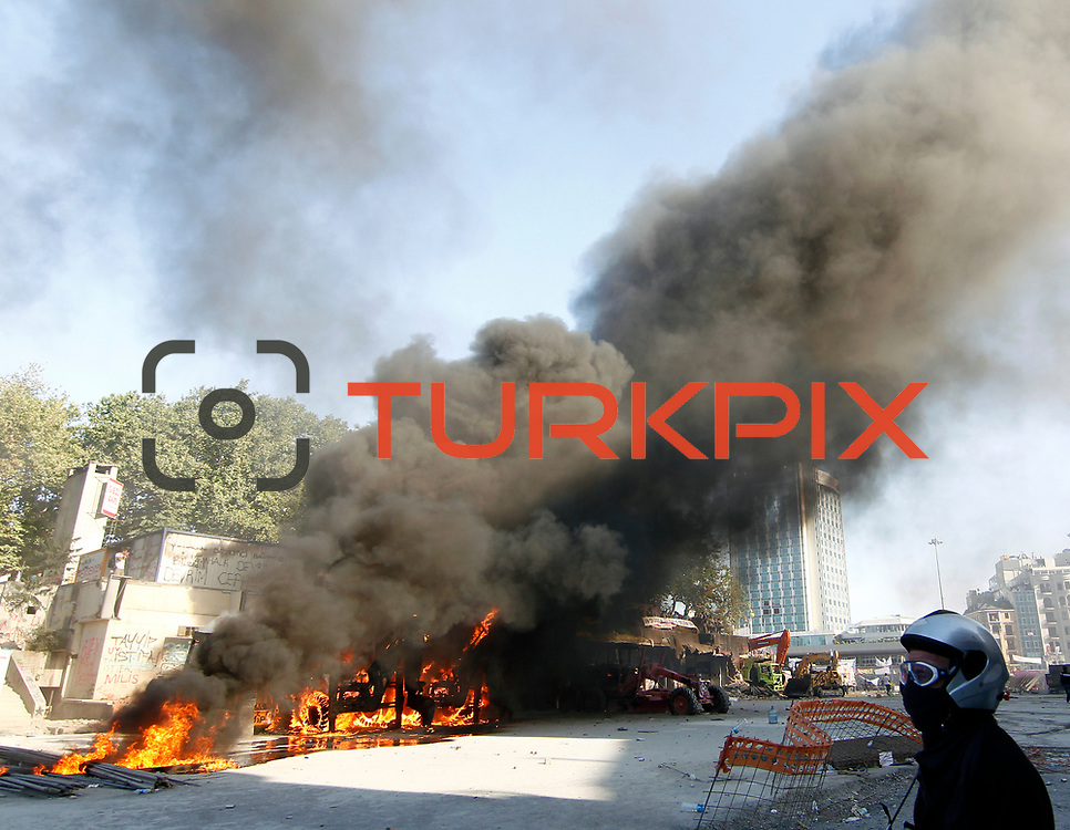 An excavaor vehicle is set to flames during a clash with Turkish riot police at Taksim Square in Istanbul, Turkey, 11 June 2013. Photo by AYKUT AKICI/TURKPIX