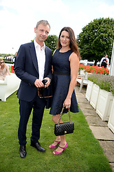 JOHN SIMM and KATE McGOWAN at the Audi International Polo at Guards Polo Windsor Great Park, Egham, Surrey on 28th July 2013.