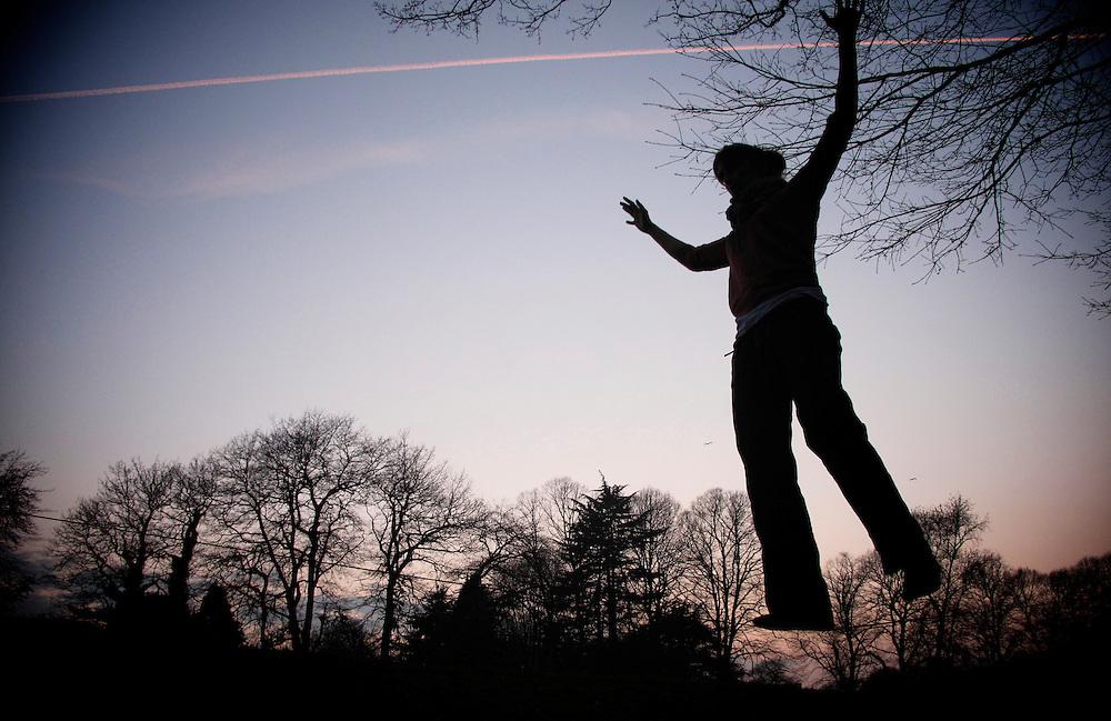 Slackliner Lisa Carnie enjoying the sunset in Bute Park, Cardiff.