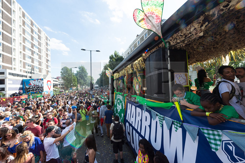 © Licensed to London News Pictures. 27/08/2017. London, UK. Revellers and performers enjoy the first day of Notting Hill Carnival in west London. It is second largest street festival in the world after the Rio Carnival in Brazil, attracting over 1 million people. Photo credit: Ray Tang/LNP