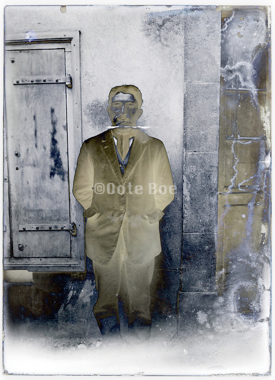 severely eroding glass plate with impression of man standing by window