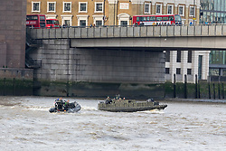© Licensed to London News Pictures. 23/10/2018. London, UK. Royal Marines in a RIB travel on the River Thames under London Bridge during a rehearsal for a display tomorrow when the Royal Marines and Royal Netherlands Marines will stage a joint on water capability demonstration with blank ammunition. As part of the Dutch state visit, King Willem-Alexander and Queen Máxima will attend the Dutch ship HNLMS Zeeland, which is anchored next to HMS Belfast. They will join The Duke of Kent on board and will be given a 10 minute display of the Royal Marines and Royal Netherlands Marines staging a joint on water capability demonstration.Photo credit: Vickie Flores/LNP