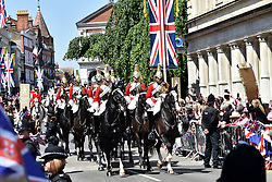 The Household Cavalry lead the carriage procession through Windsor after the Royal wedding