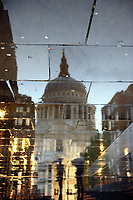 St Paul's Cathedral, London, at night, reflected in the rainy streets