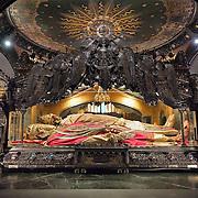 MILAN, ITALY - DECEMBER 07:  Pilgrim,  walks past the relics of Saint Ambrogio on December 7, 2010 in Milan, Italy. The skeleton of Saint Ambrogio lays with the remains of San Gervasio e San Protasio in the ancient basilica of Sant'Ambrogio in the city centre of Milan