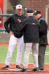 25 May 2013: Mark Kingston and Gene Stephenson speak with home plate umpire Greg Harmon during an NCAA division 1 Missouri Valley Conference (MVC) Baseball Tournament game between the Wichita State Shockers and the Illinois State Redbirds on Duffy Bass Field, Normal IL