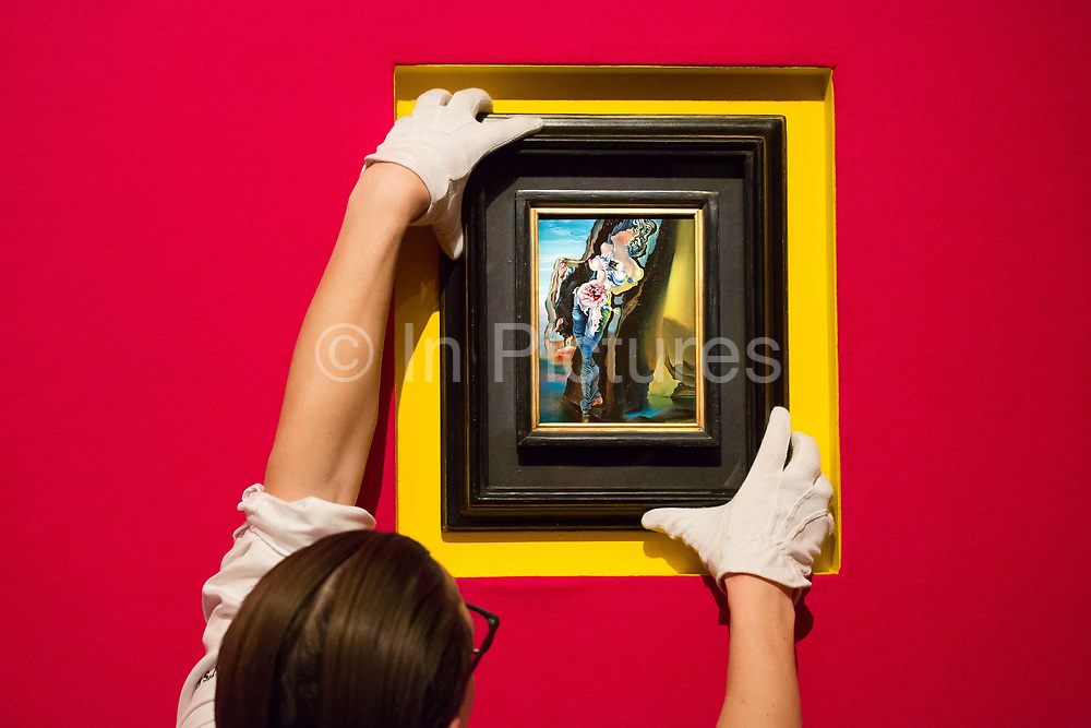A member of staff holds Gradiva 1931 by Salvador Dali on February 22nd, 2018 at the preview for Sothebys upcoming Impressionist, Modern and Surrealist Art auction at Sothebys in New Bond Street, London, England.