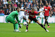 Swansea city's Nathan Dyer © is denied by Man Utd keeper David de Gea and Nemanja Vidic.. Barclays Premier league, Swansea city v Manchester Utd in Swansea, South Wales on Saturday 17th August 2013. pic by Andrew Orchard ,Andrew Orchard sports photography,