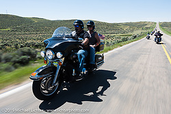 Jim and CandaiceRupa of the Denver HOG Chapter on their 2008 Electra Glide Classic riding from Steamboat Springs, Colorado, to Baggs, Wyoming during the Rocky Mountain Regional HOG Rally, USA. Friday June 9, 2017. Photography ©2017 Michael Lichter.