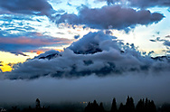 Imbabura, just before sunrise, swaddled in thick clouds.