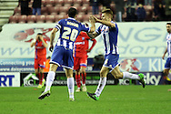 Wigan Midfielder Max Power celebrates during the Sky Bet League 1 match between Wigan Athletic and Gillingham at the DW Stadium, Wigan, England on 7 January 2016. Photo by Pete Burns.