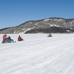 Snowmobiling on Moosehead Lake in Rockwood, Maine.  Mount Kineo is in the distance.