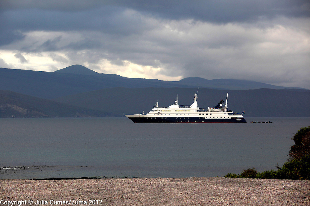 The Celebrity Xpedition Cruise ship is photographed anchored off Fernandina Island in the Galapagos.