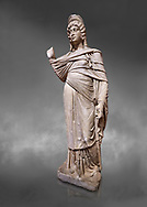 Roman statue of Julia Domina . Marble. Perge. 2nd century AD. Inv no 3268. Antalya Archaeology Museum; Turkey.<br /> <br /> Julia Domna (AD 160–217) was a Roman empress , the second wife of Septimius Severus (reigned 193–211).  Against a grey background .<br /> <br /> If you prefer to buy from our ALAMY STOCK LIBRARY page at https://www.alamy.com/portfolio/paul-williams-funkystock/greco-roman-sculptures.html . Type -    Antalya     - into LOWER SEARCH WITHIN GALLERY box - Refine search by adding a subject, place, background colour, museum etc.<br /> <br /> Visit our ROMAN WORLD PHOTO COLLECTIONS for more photos to download or buy as wall art prints https://funkystock.photoshelter.com/gallery-collection/The-Romans-Art-Artefacts-Antiquities-Historic-Sites-Pictures-Images/C0000r2uLJJo9_s0