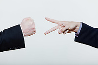 two men playing rock paper scissors on studio isolated white background