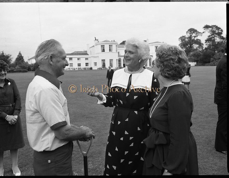 1983-07-05.5th July 1983.05-07-1983.07-05-83..Photographed at US Embassy Residence, Dublin..Barbara Bush, wife of US Vice President George Bush chatting with guests in US Embassy Residence grounds.