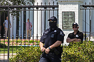 """Security in front of the  Louisiana Governor's Mansion during An 'End the Shutdown"""" protest in Baton Rouge. LA on April 25, 2020 in Baton Rouge , Louisiana. A group of a few dozen people who want the restrictions Gov. John Bel Edwards put in place to stop the spread of COVID-19 lifted, held a rally in front of the State Capitol Building on Saterday, before marching to the Governors Mansion where they called on him to end the shut down."""